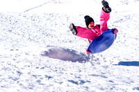 Young Girl on Sled in Winter