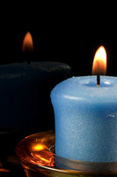 Blue Lighted Candle and Reflection