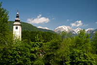 Curch on Lake Bohinj and the Julian Alps